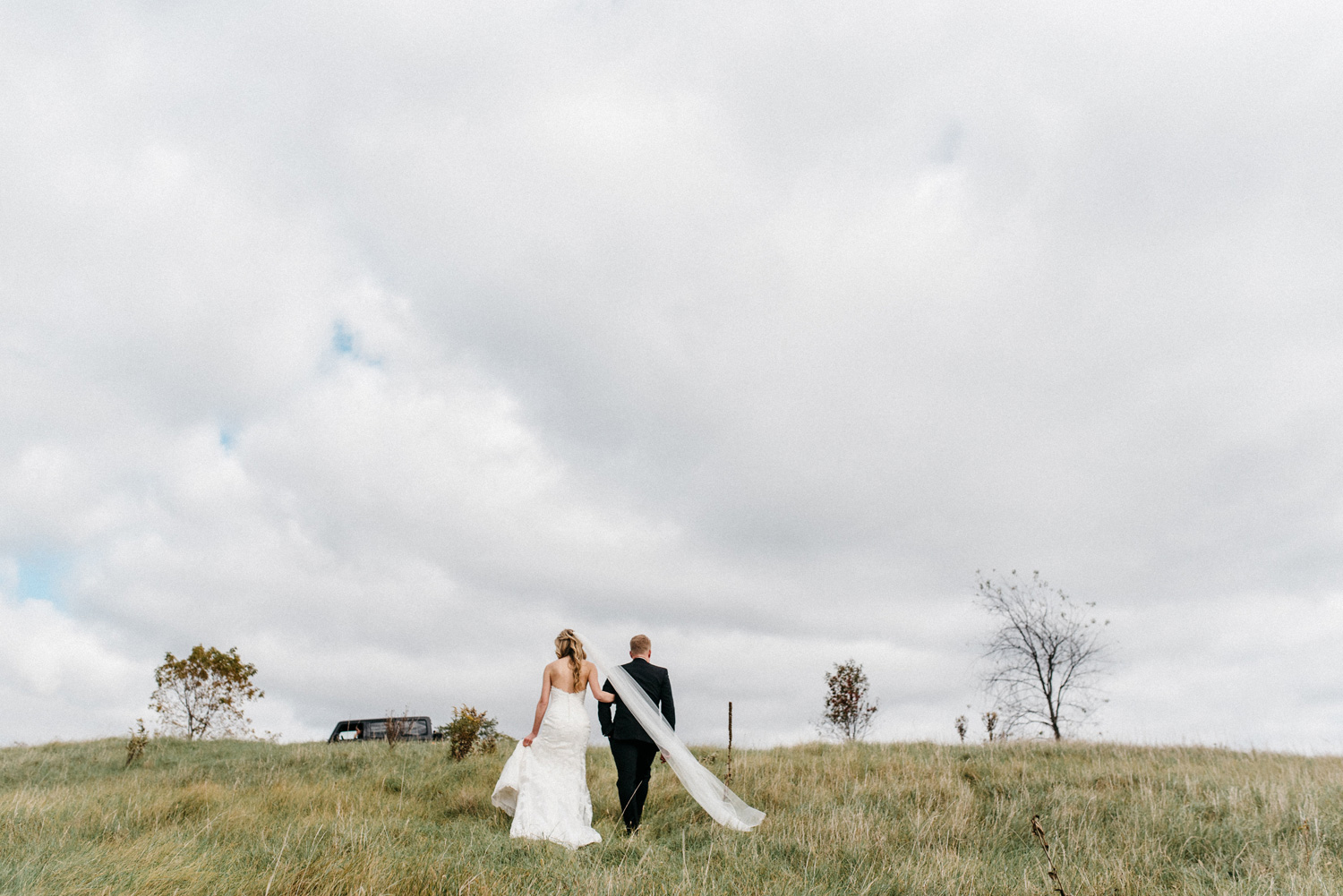Bride and Groom Portrait walking at Birch Hill Barn capture by Geneoh Photography