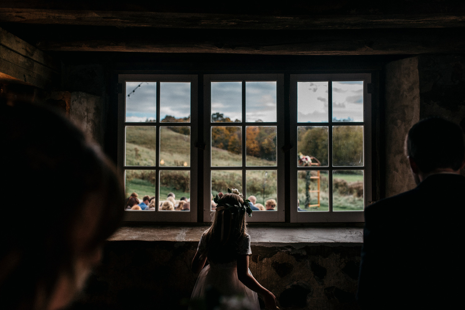 Flower girl watching ceremony at birch hill barn