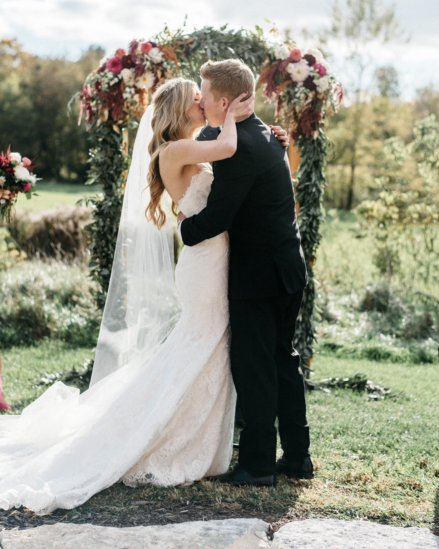 Outdoor ceremony kiss at Birch Hill Barn by Geneoh Photography