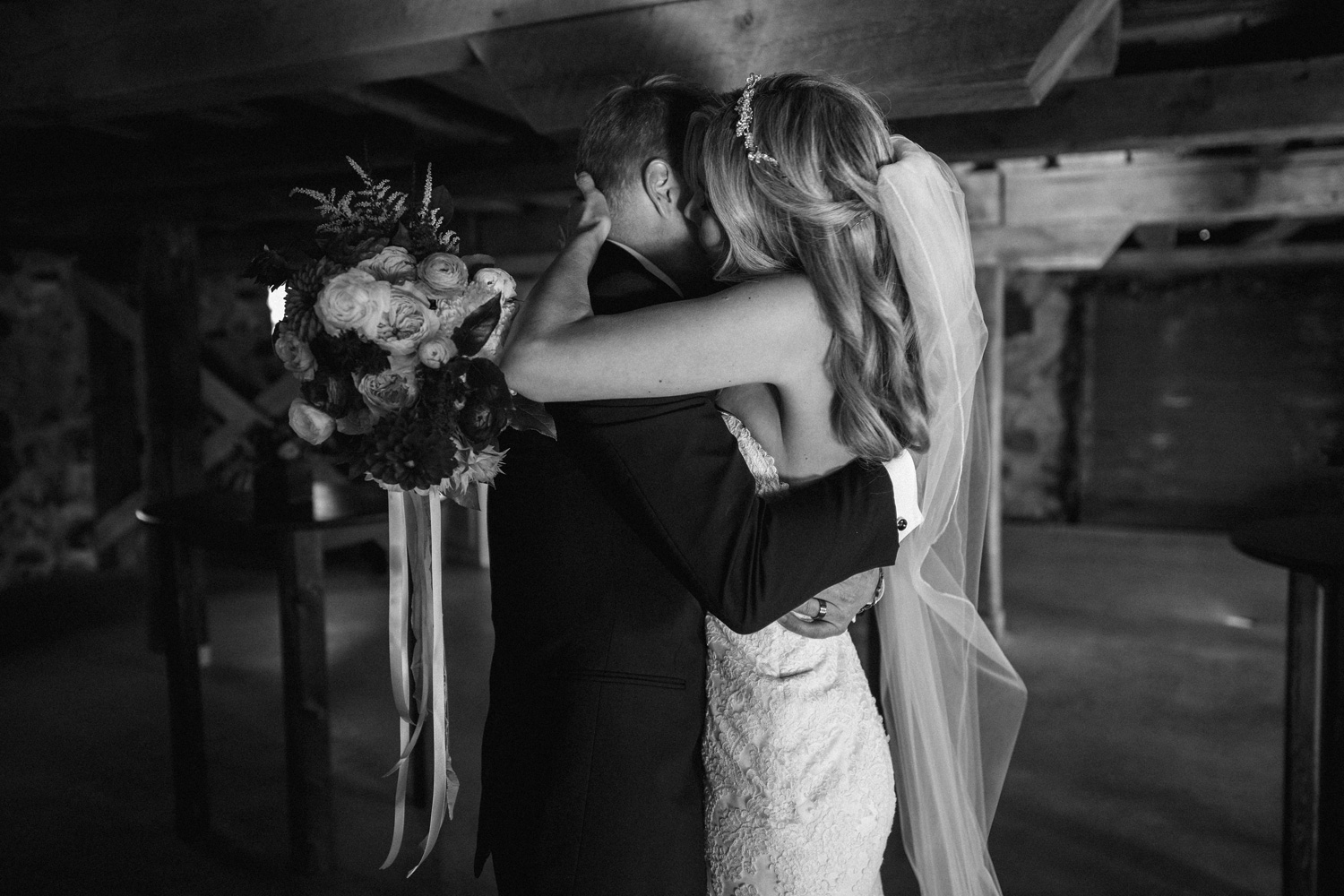 Emotional Hug between bride and groom