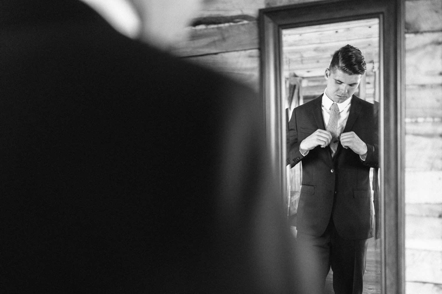 Groom getting ready at Southwind Hills by geneoh photography