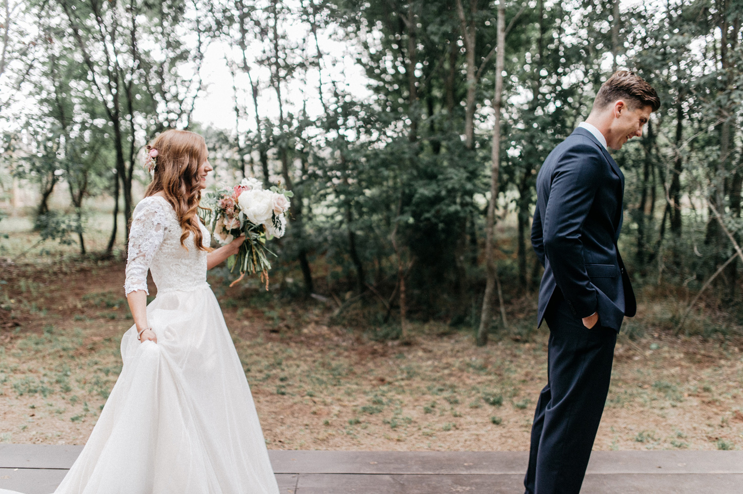 Bride and Groom first look at Southwind Hills by geneoh photogra