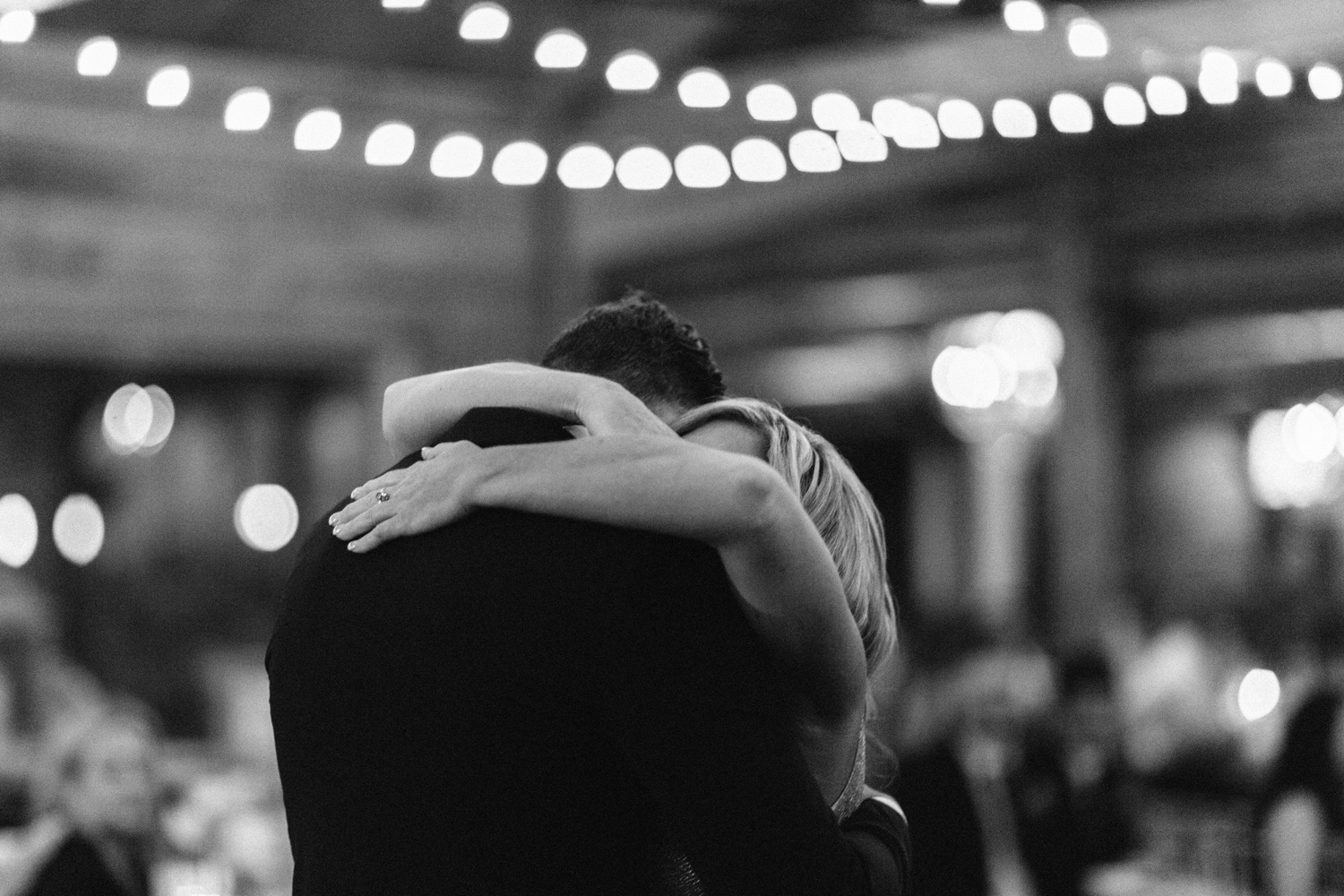 Groom and Mother hug after dance at Southwind Hills