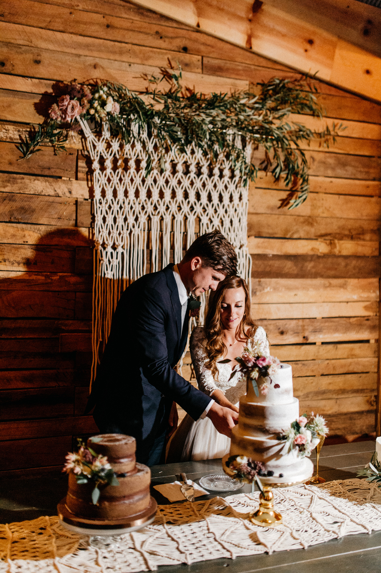 Bride and Groom cut the cake during reception at Southwind Hills