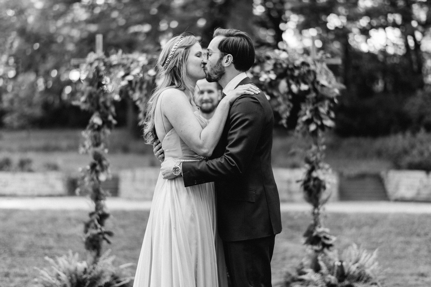Bride and groom share first kiss together during wedding at Des Moines Art Center