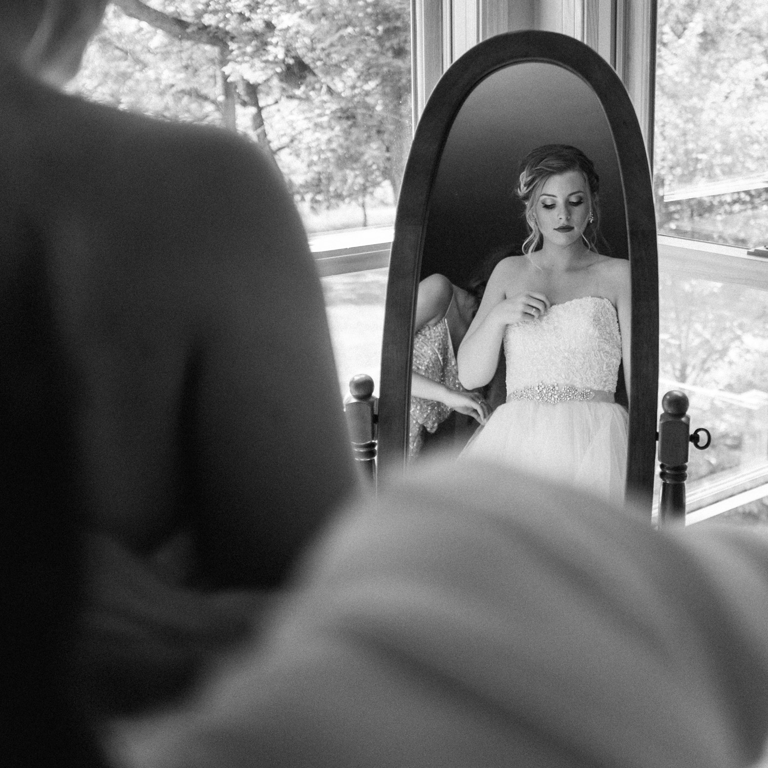 bride putting her dress on at rustic oaks fuji x100t