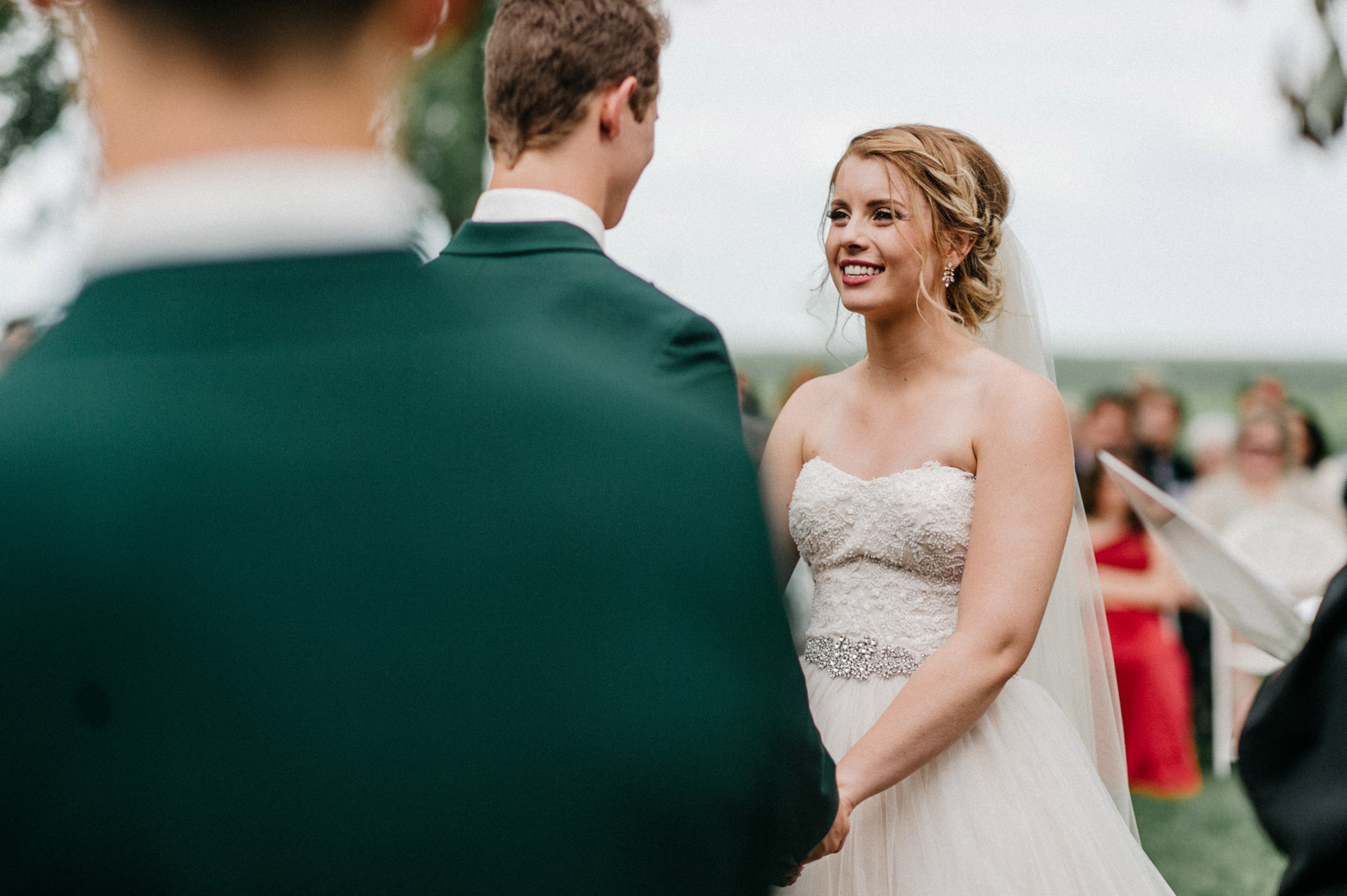 bride during outdoor ceremony at rustic oaks