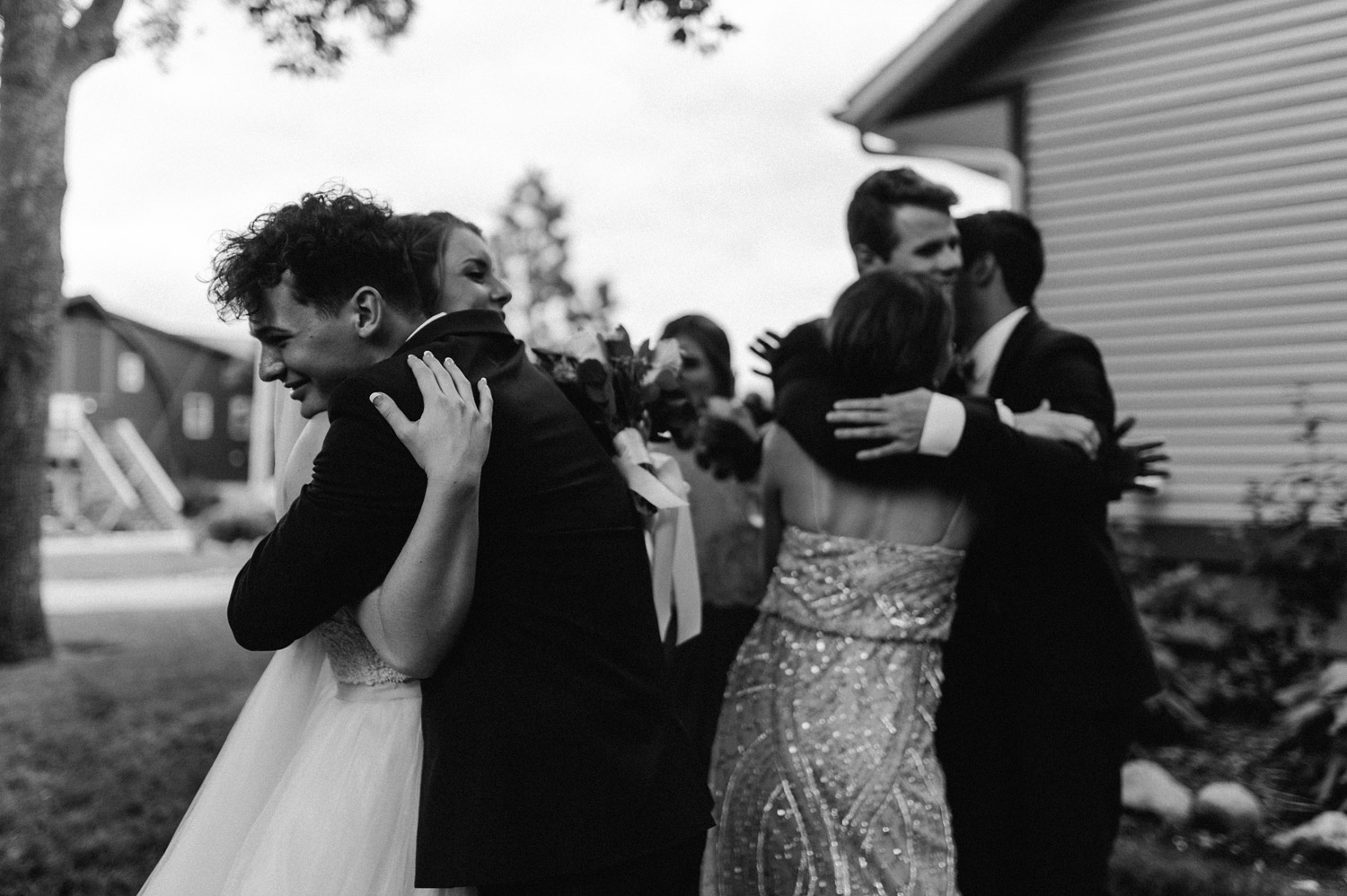candid of bride and groom celebrating with friends and family after ceremony by geneoh photography