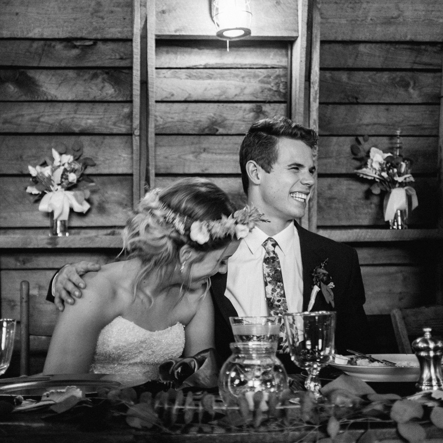 Bride and groom react to speeches during reception at rustic oaks by geneoh photography