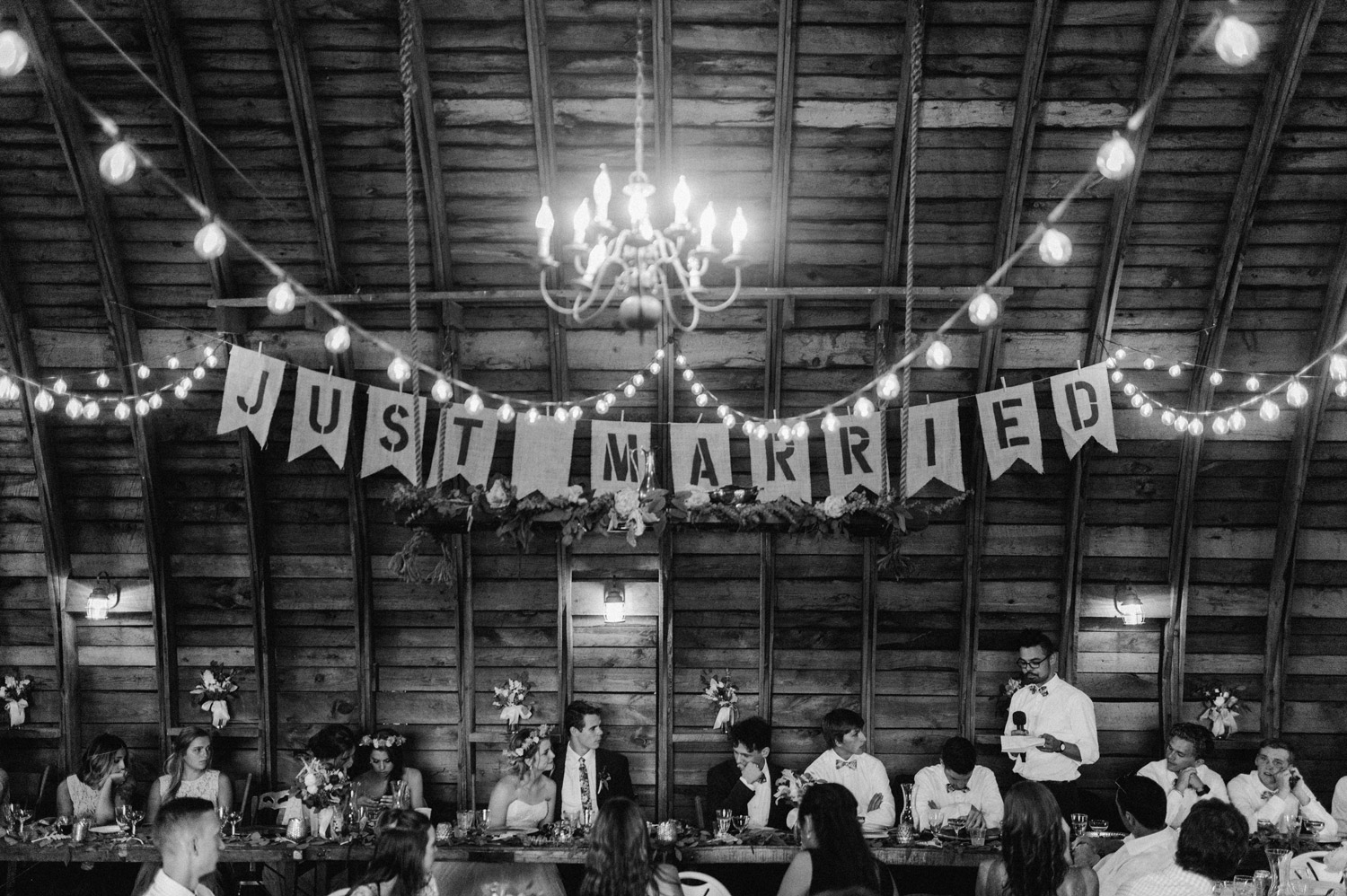 groomsmen giving speech during reception at Rustic Oaks by geneoh photography