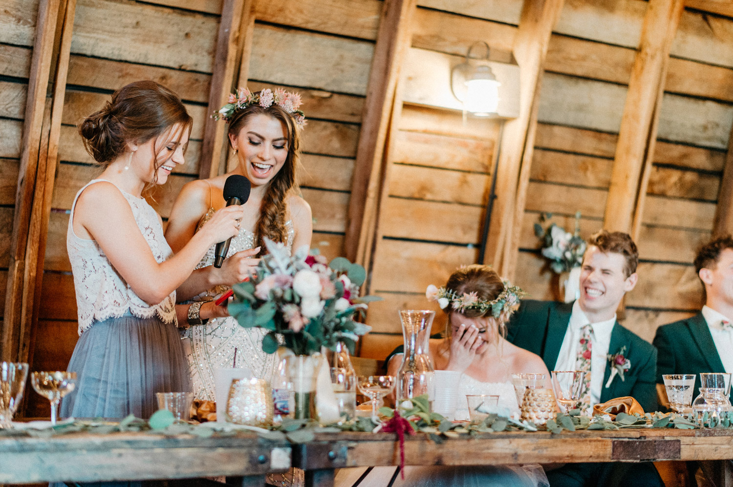 bridesmaids give speech during reception at rustic oaks