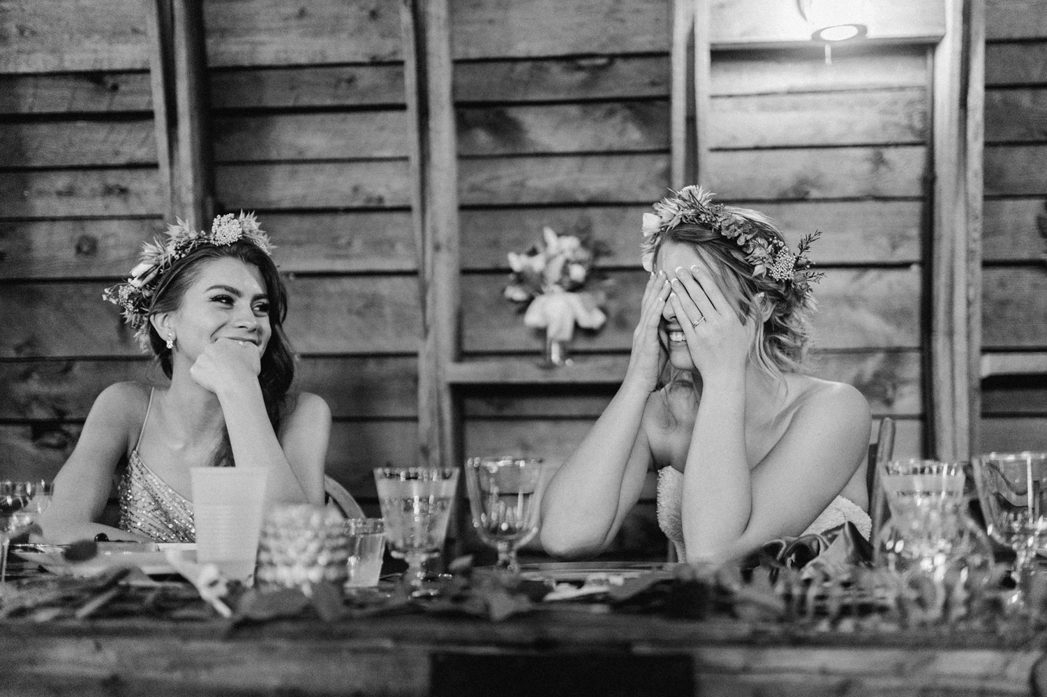 bride reacts to speech during reception at rustic oaks by geneoh