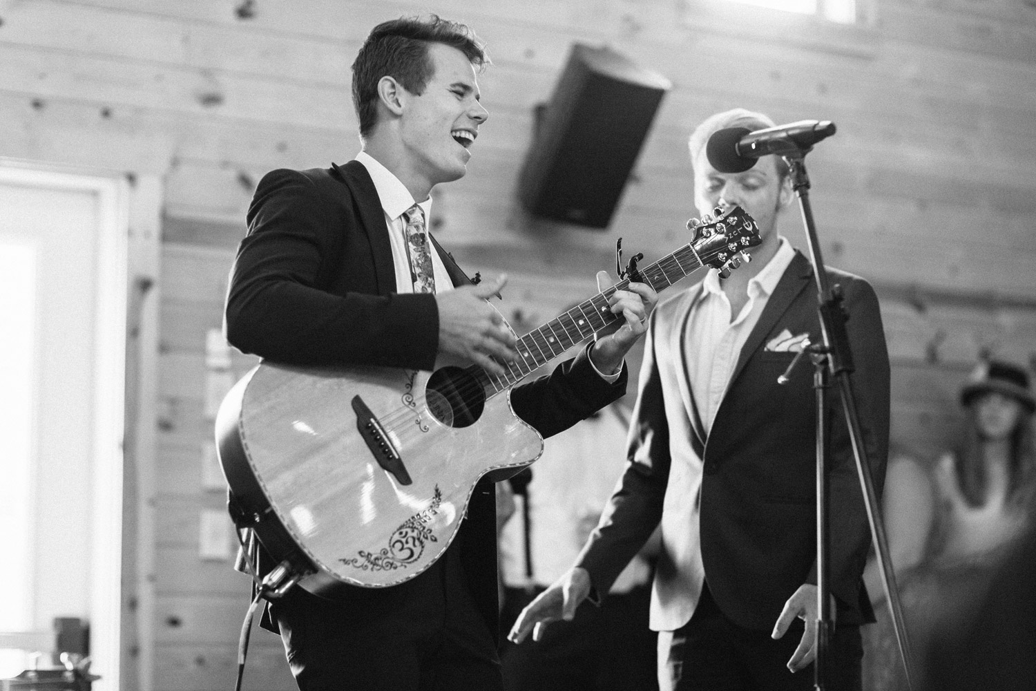 groom sings to bride during reception at Rustic Oaks by geneoh