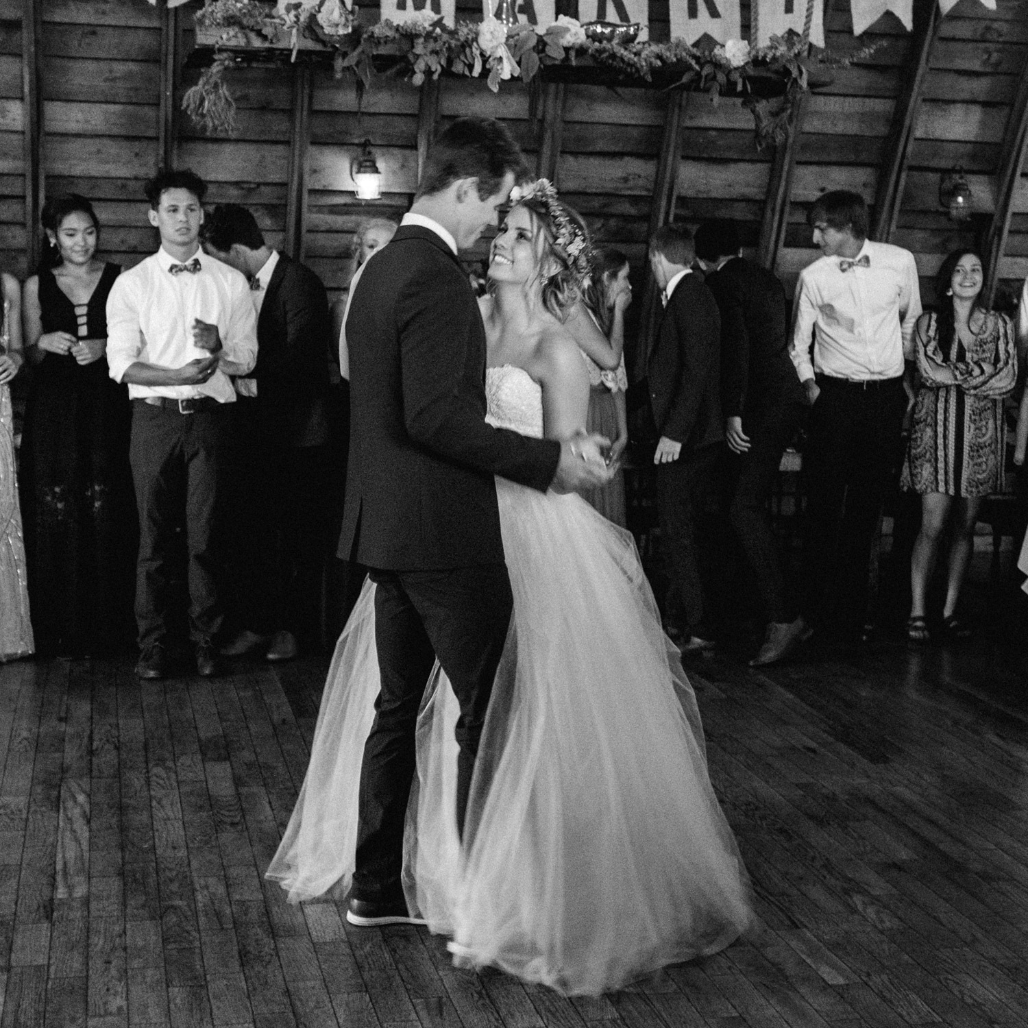 bride and groom during first dance at rustic oaks