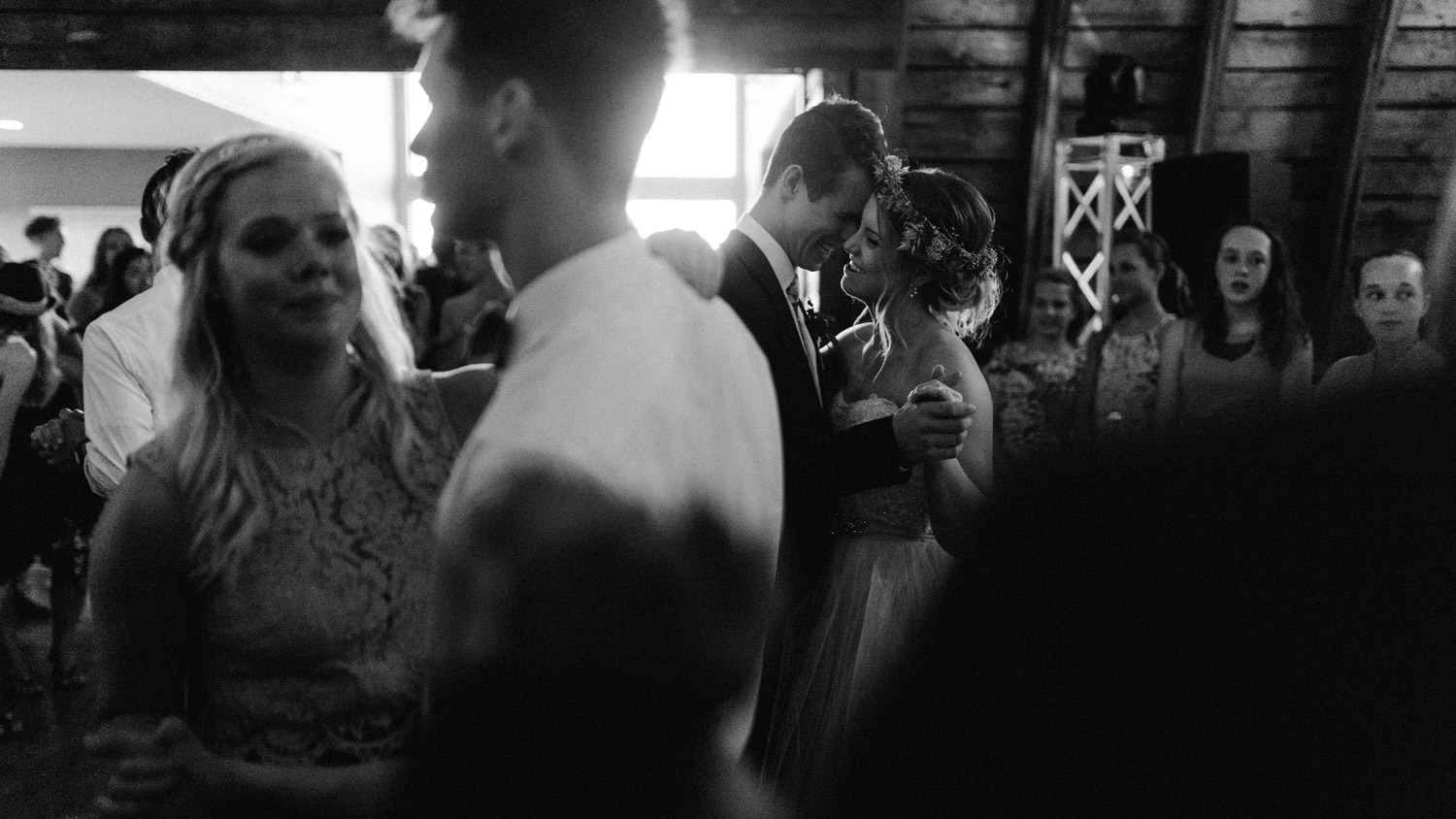 bride and groom dancing during reception at rustic oaks by geneoh