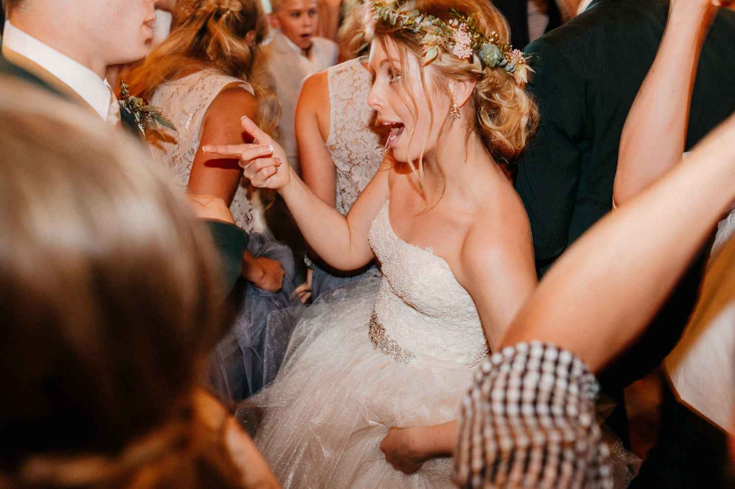 bride dancing during reception at rustic oaks by geneoh photography