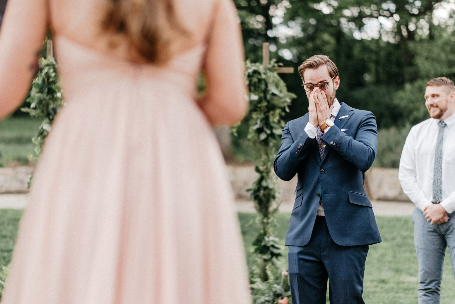 Emotional Groom seeing Bride walk down the aisle by geneoh photography