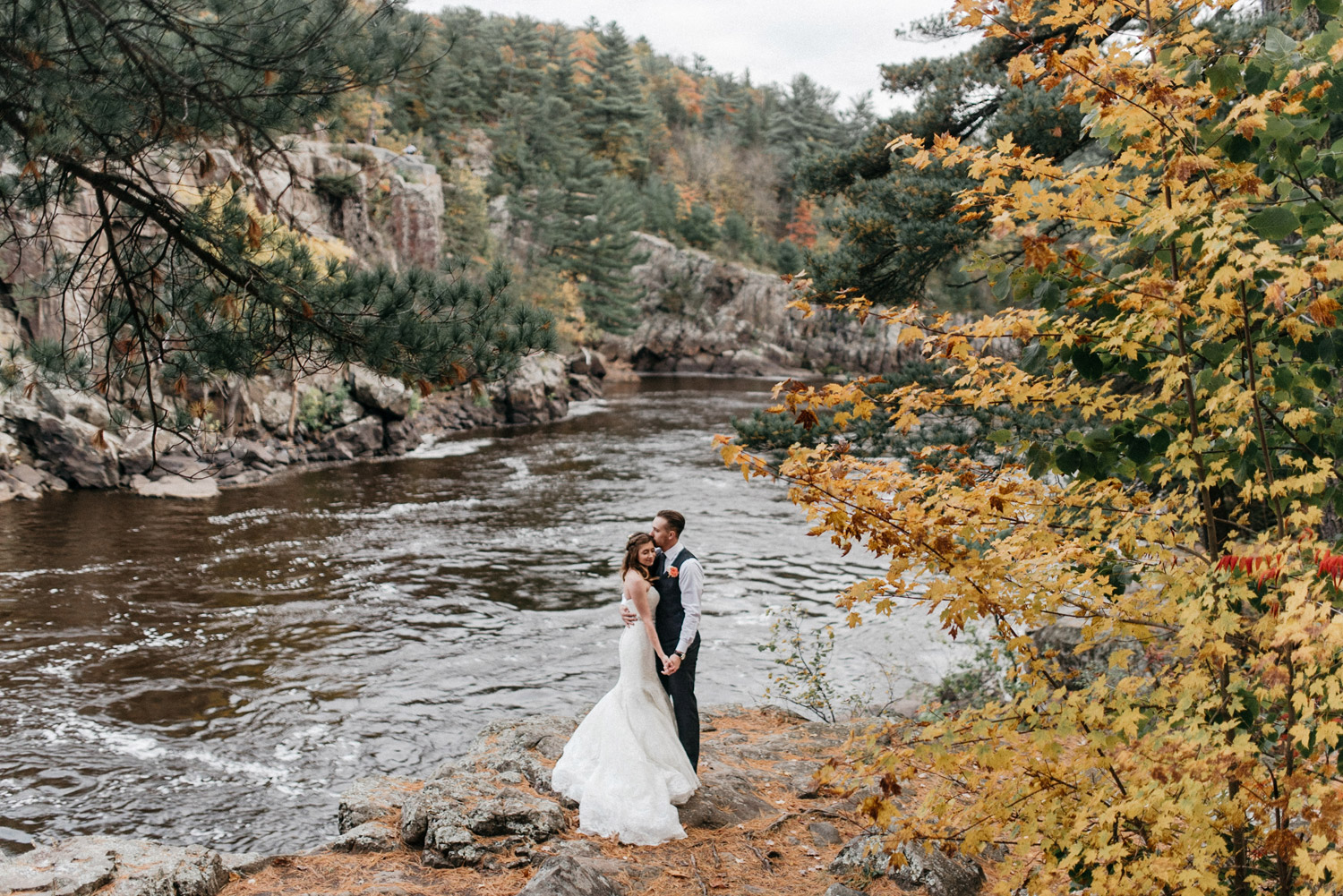 Portrait of bride and groom at Taylors falls Minnesota by geneoh photography