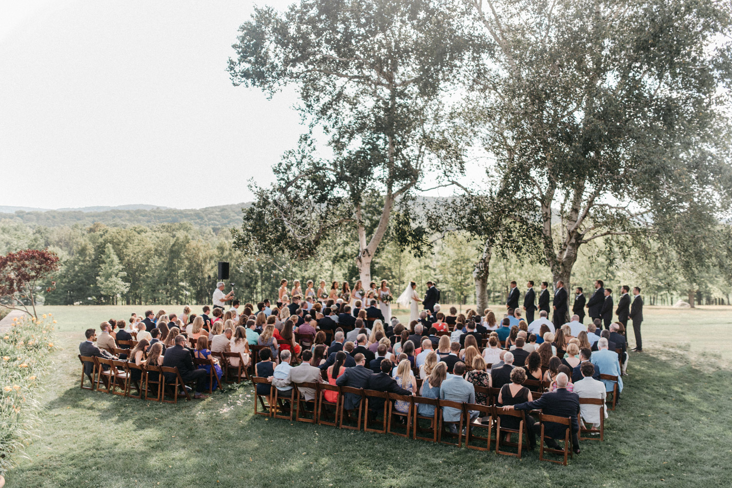 Outdoor wedding ceremony by geneoh photography