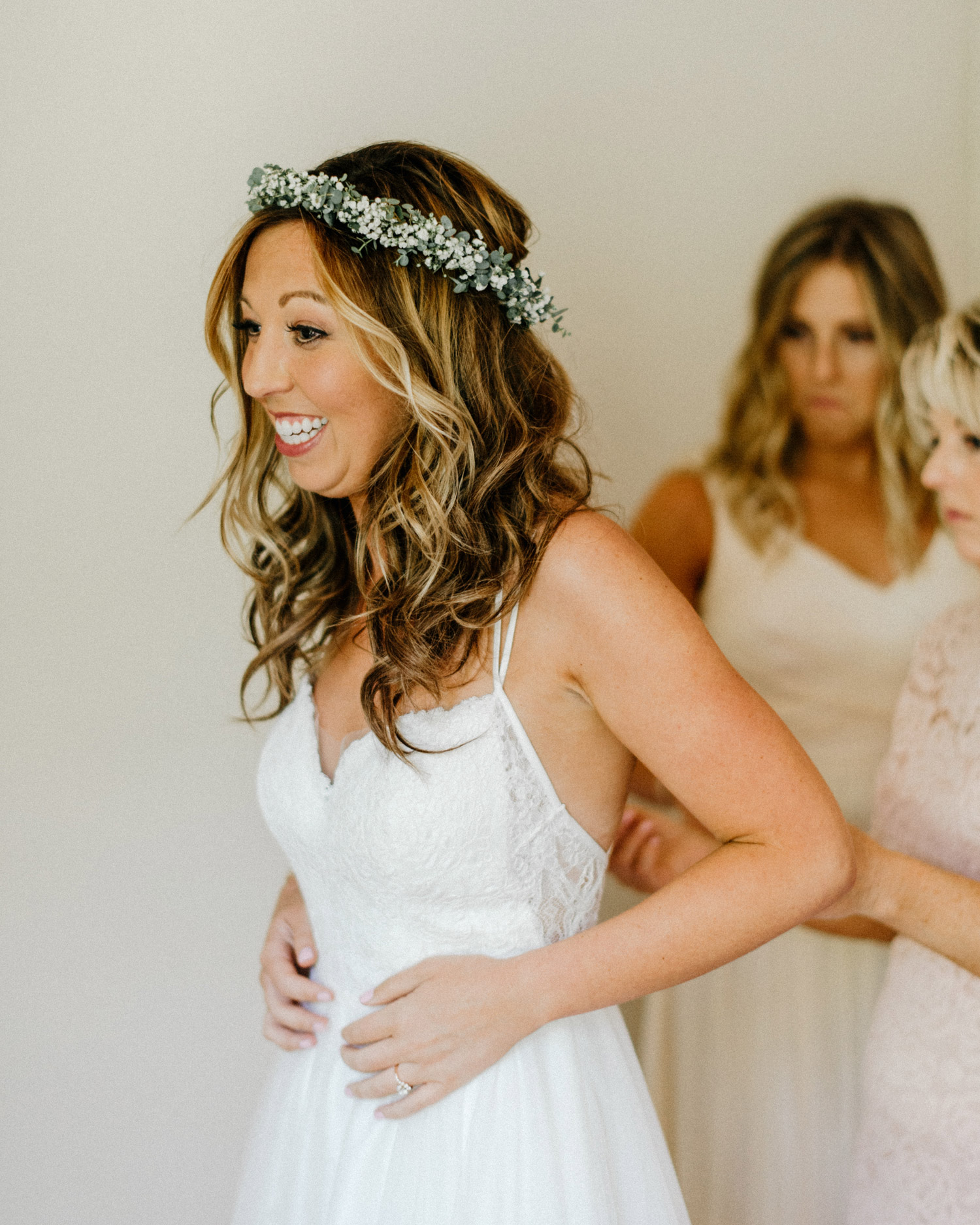 Bride putting her dress on by Geneoh Photography