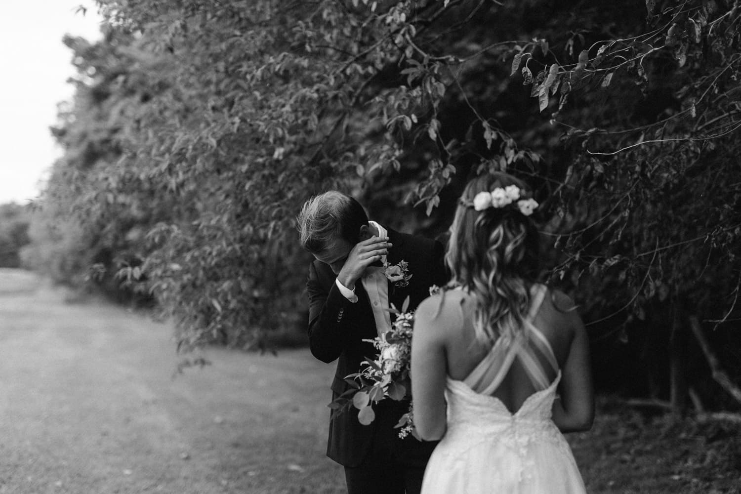 groom tearing up during first look