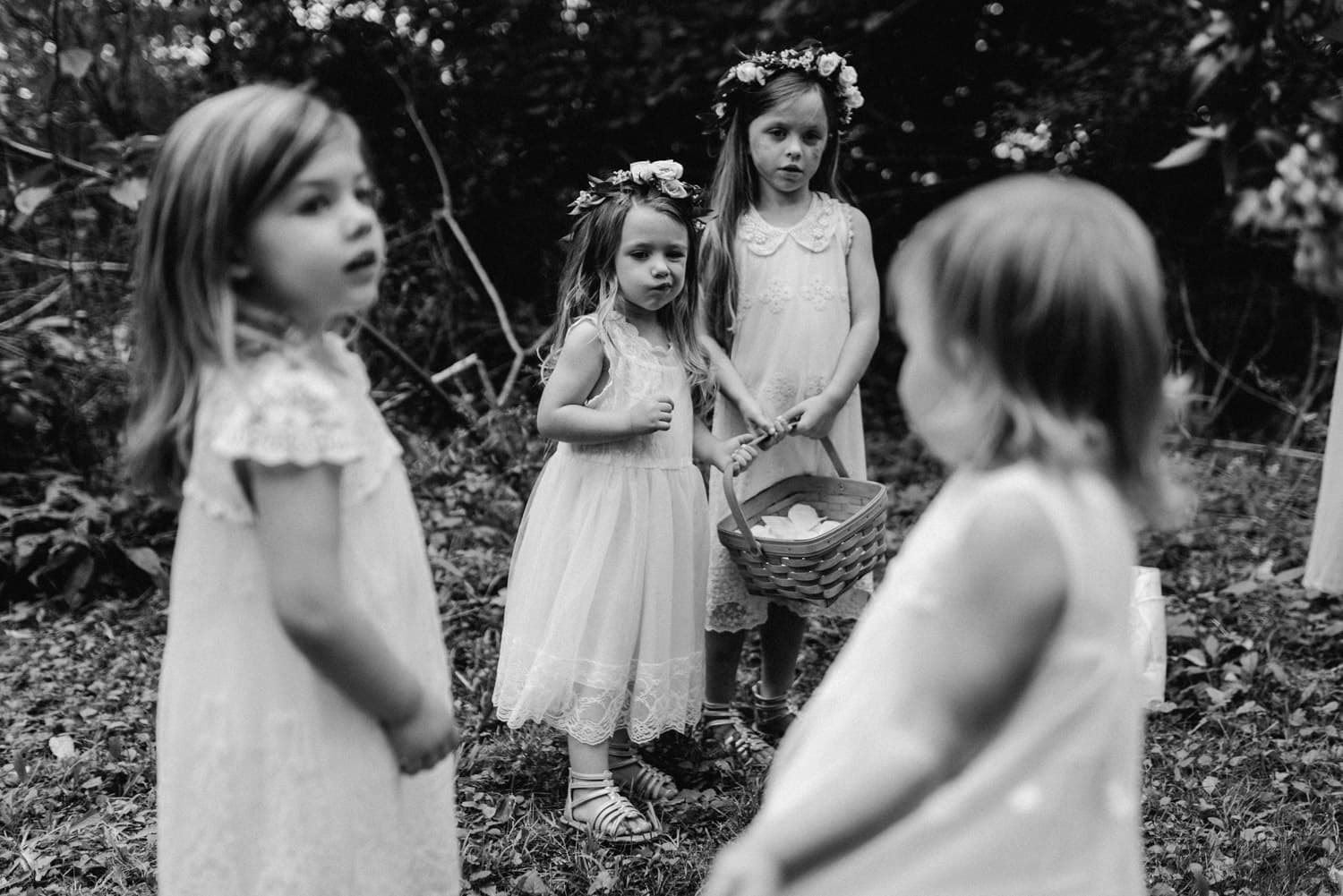 candid moment of kids at outdoor wedding