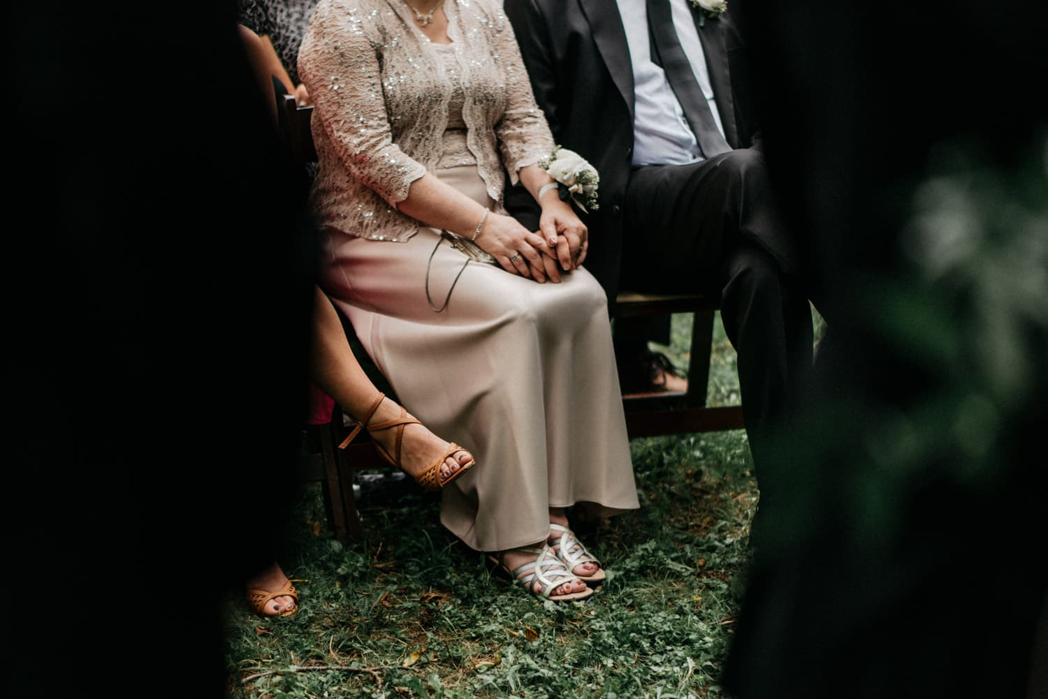 father and mother hold hands during wedding ceremony