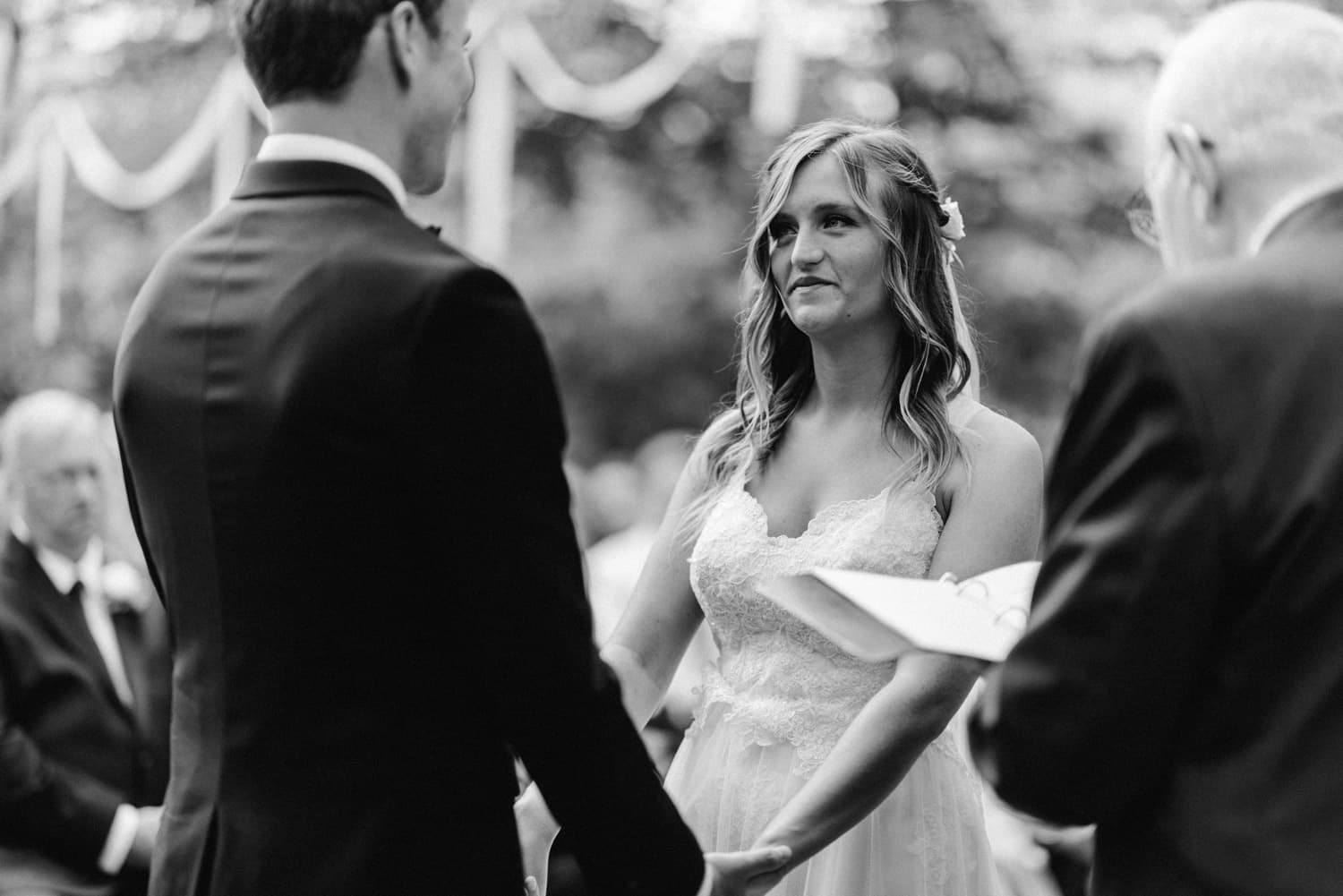 bride looking at groom during outdoor ceremony