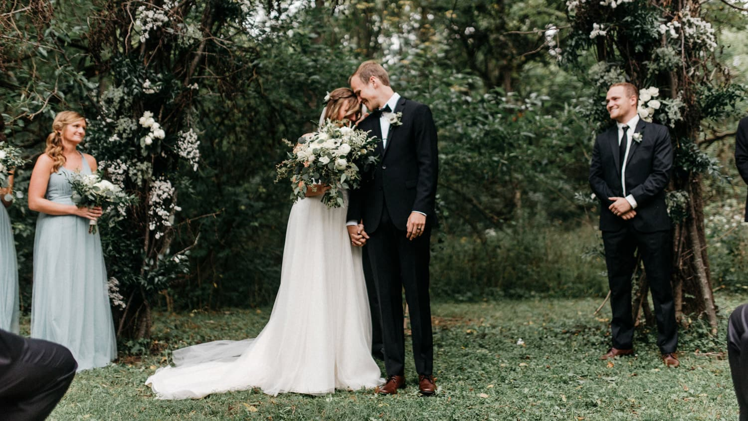 bride and groom share moment together during their outdoor ceremony