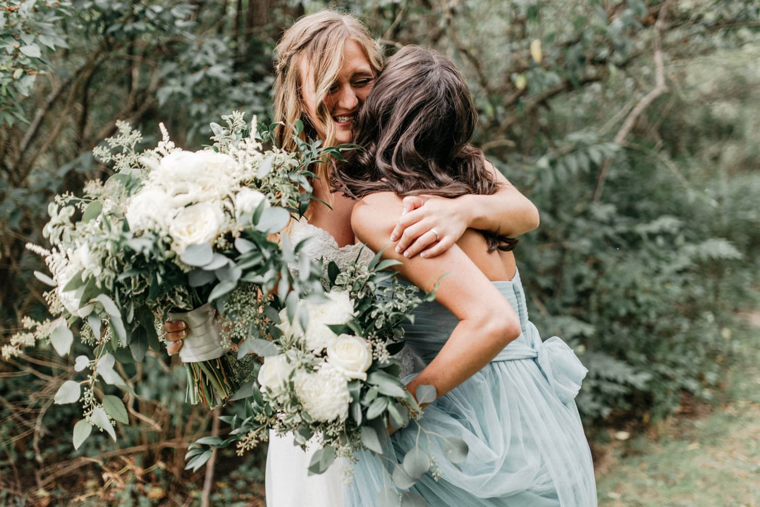 emotional moment between bride and bridesmaid