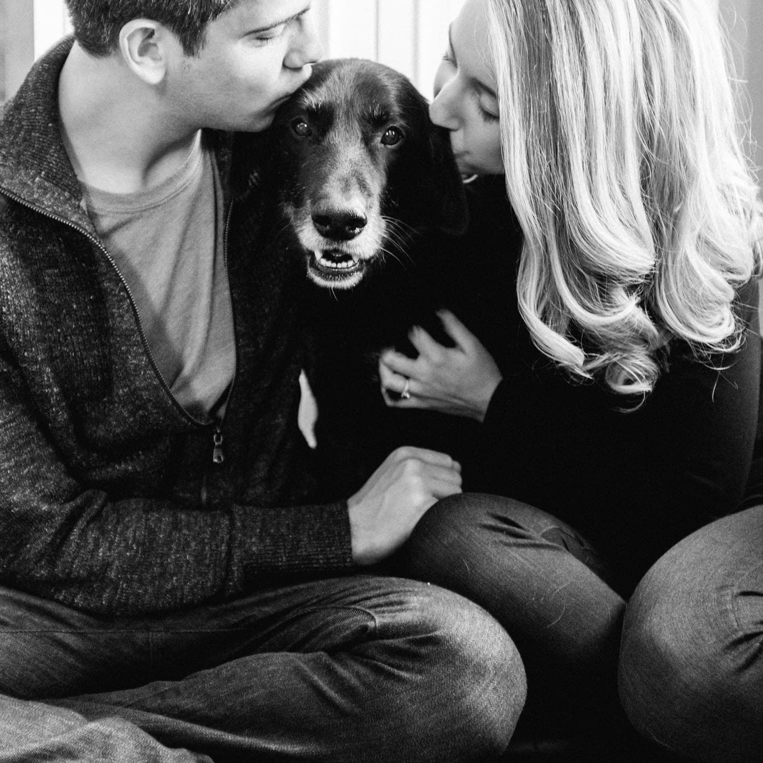 Couple with dog in home session